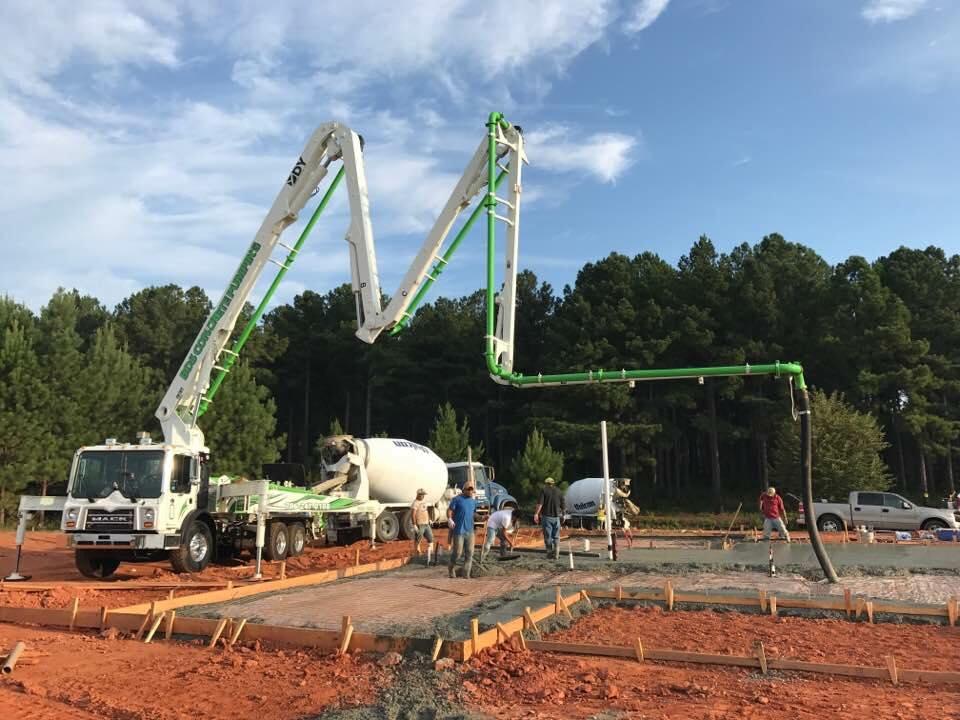 DY Concrete Pumps 33 meter zz concrete boom pump in action on a jobsite