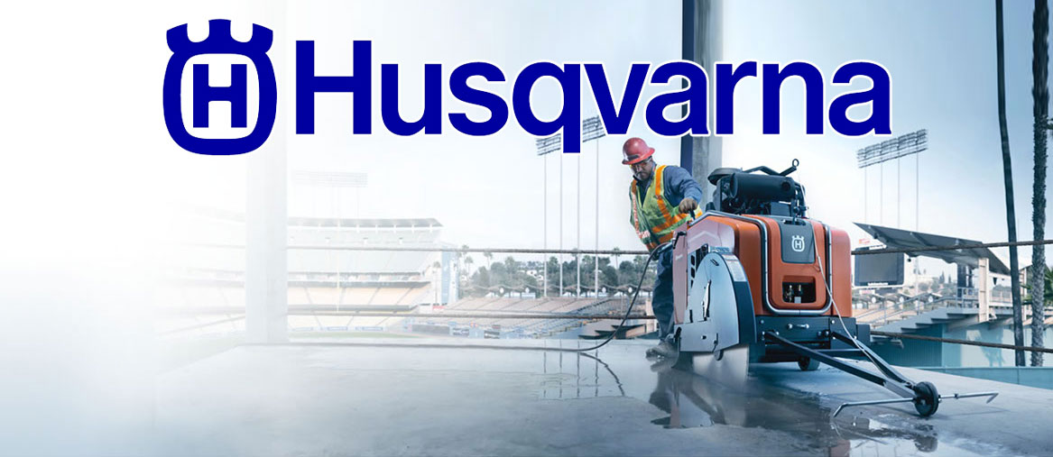 concrete contractor using a Husqvarna floor saw to complete a project at a stadium