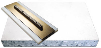 plastic power trowel blade on top of a concrete slab